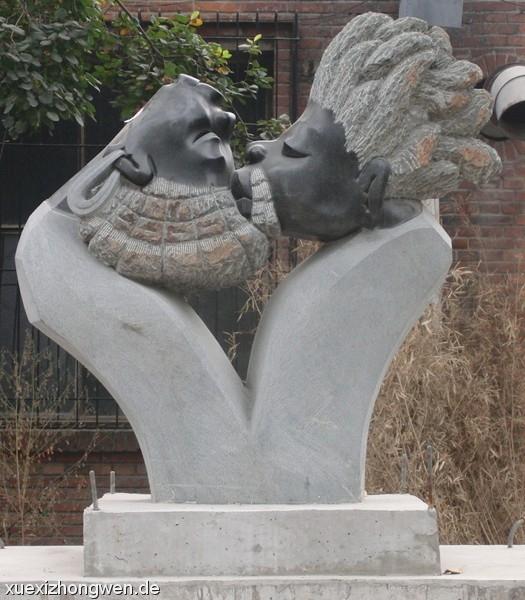 Küssende Köpfe